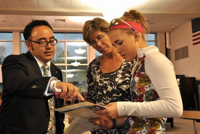 Steamboat Springs High School junior Gretchen Burkholder, right, and her mom, Amy, talk with University of Colorado Assistant Director of Admissions Zeni Tsubokawa Whittall on Tuesday night during the high school's college fair.