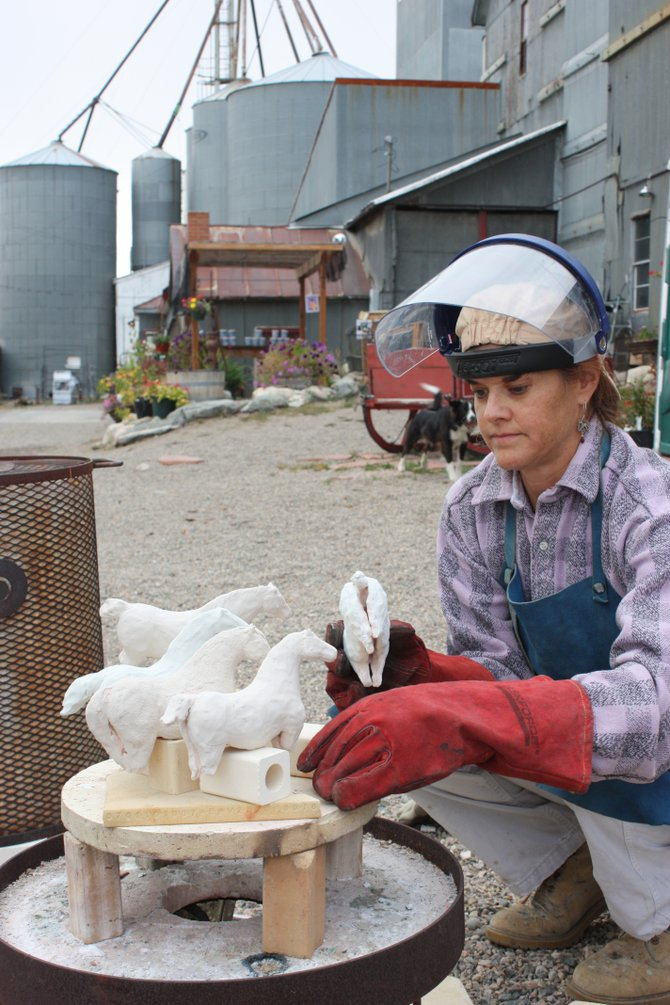 Amy Laugesen, of Denver, works at the Hayden Granary on her ceramic horses inspired by Hayden's rich quarter horse heritage.