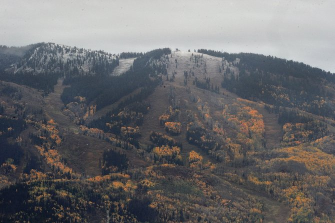 A dusting of snow could be seen on the slopes of Steamboat Ski Area as a storm moved through the area reminding us that it&#39;s fall and that winter and more snow are just around the corner.