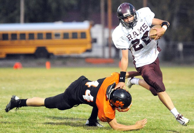 Soroco's Nic Paxton cuts around a Hayden defender in Friday's 49-7 loss. The Rams hope to bounce back from a defeat at the hands of their cross-county rivals with a victory in this week's matchup against the Vail Christian Saints.