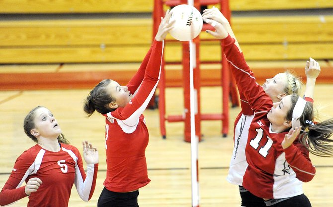Steamboat's Alex Feeley, right front, and Maggie Crouch fight for a ball at the net Thursday. The Sailors fell to the Glenwood Springs Demons in four games. They return to the court Friday night at home against Eagle Valley.