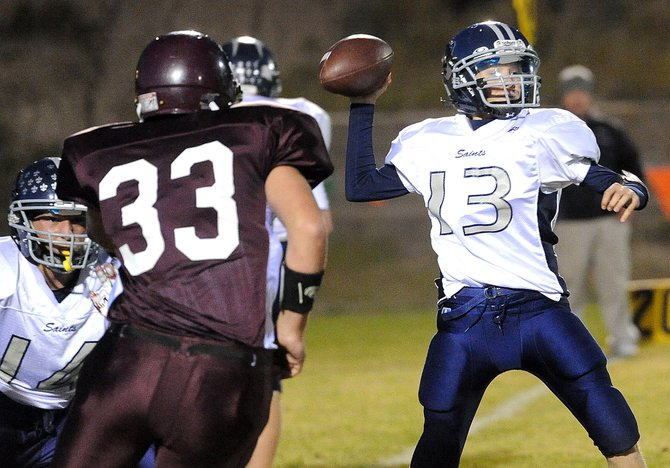 Vail Christian&#39;s Austin Ellsworth gets a pass off through the Soroco defense Friday night in Oak Creek. The Saints offense wasn&#39;t great, but its defense more than made up for that. Vail Christian won the game, 26-6.
