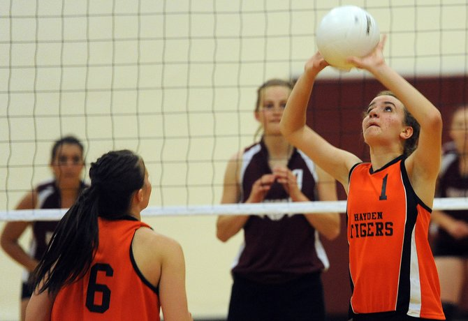 Hayden's Becca Hoza sets the ball Friday as the Tigers beat Soroco in three games.
