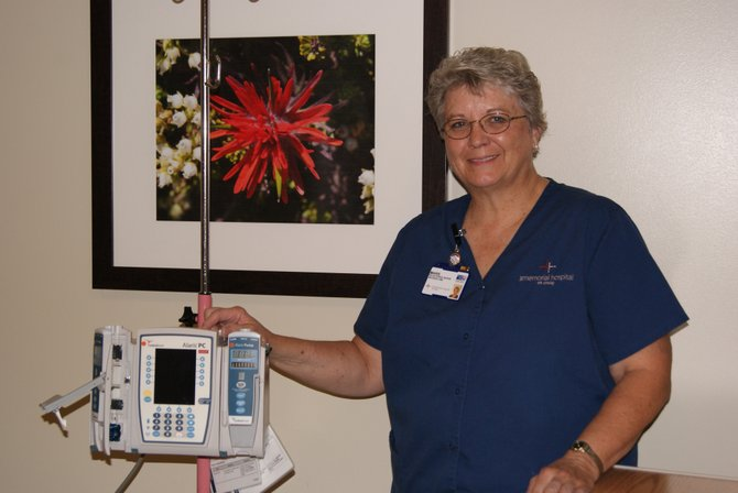 Nurse Marie Kettle stands next to a machine she uses in the infusion clinic at The Memorial Hospital at Craig.