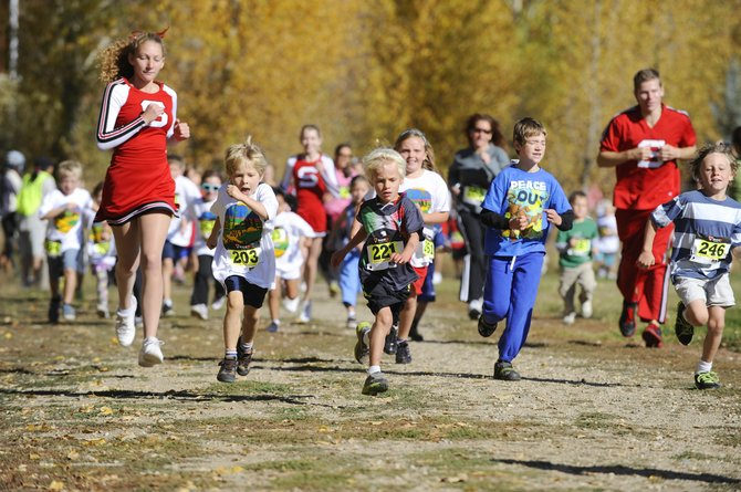 Runners round the track at Steamboat Springs Middle School during the Steamboat Sneak fun run Saturday. 