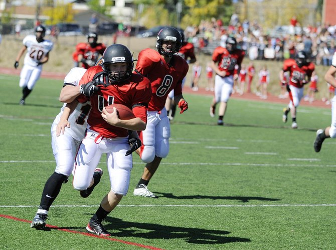 Steamboat Springs High School sophomore Billy Clark tries to break a tackle during Saturday's game against Montezuma-Cortez. The Sailors won, 47-7.