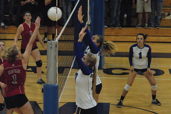 Laurel Tegtman (front) and Brittney Rothermund go up for a block during the second set of Tuesday's match against Grand Valley at Moffat County High School. The Bulldogs won in five sets.
