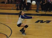 Lisa Camilletti digs a hit out Tuesday night at Moffat County High School. Camilletti, a senior, had 13 assists to lead the Bulldogs in their win over Grand Valley.