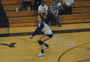 Junior Allie Ehlers prepares to dig the ball Tuesday night during the Moffat County volleyball team&#39;s match at MCHS. The Bulldogs won in five sets, and Ehlers led the way with 13 kills.