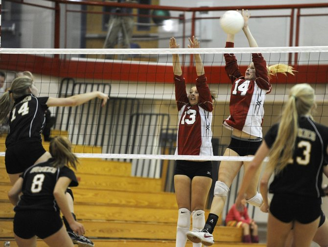 Steamboat Springs High School juniors Mikaila Jegtvig, right, and Ellie Becker go up for a block during Tuesday night's game against Battle Mountain High School.