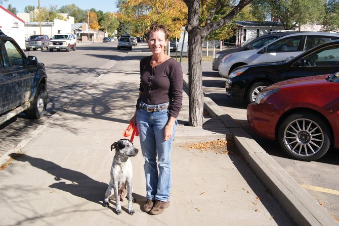Joan Heinz stands with her dog, Rally. After battling breast cancer during the past 1 1/2 years, Heinz is done with treatment and has adopted Rally from a rescue shelter in Steamboat as a reward. Heinz said they've both had a rough year and are perfect for each other.