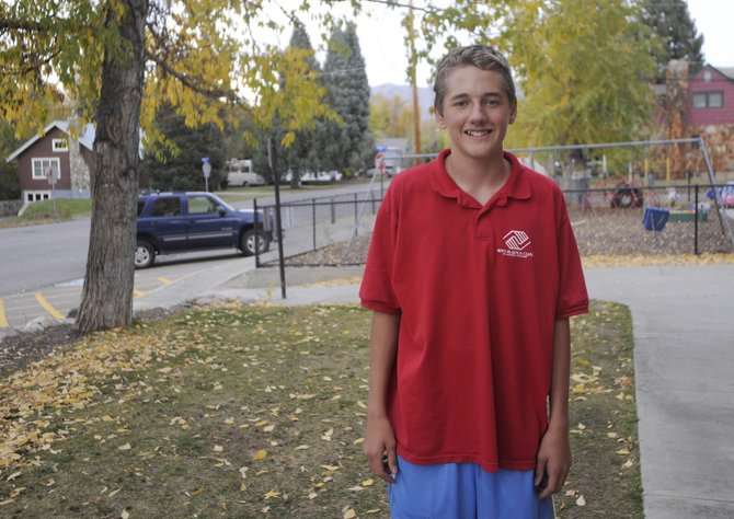 Steamboat Springs 14-year-old Dillon Silcox heard a fire alarm Saturday morning in his home and says he jumped over fire to wake up his mom.