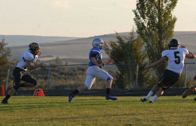 Bubba Ivers carries the ball during Moffat County's home game against Rifle this season. Ivers and the Bulldogs have lost two in a row, but are looking to get back on track with tonight's 7 p.m. homecoming game against Summit County at the Bulldog Proving Grounds.