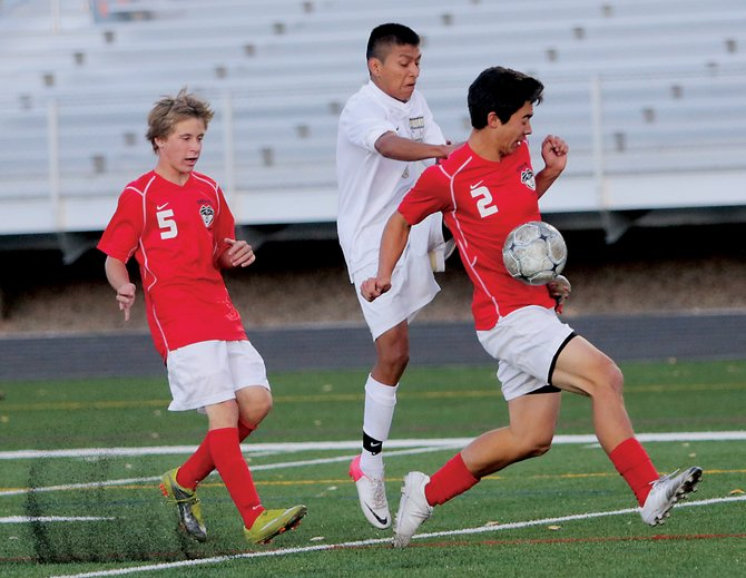 Steamboat Springs High School's Michael Wong, from right, intercepts the ball from Battle Mountain's Brandon Osorio as Will Petersen chases behind during Tuesday's game at Battle Mountain in Edwards.