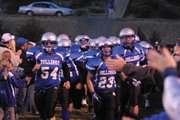 The Bulldogs run out through the fan tunnel before Friday night's game at the Bulldog Proving Grounds.