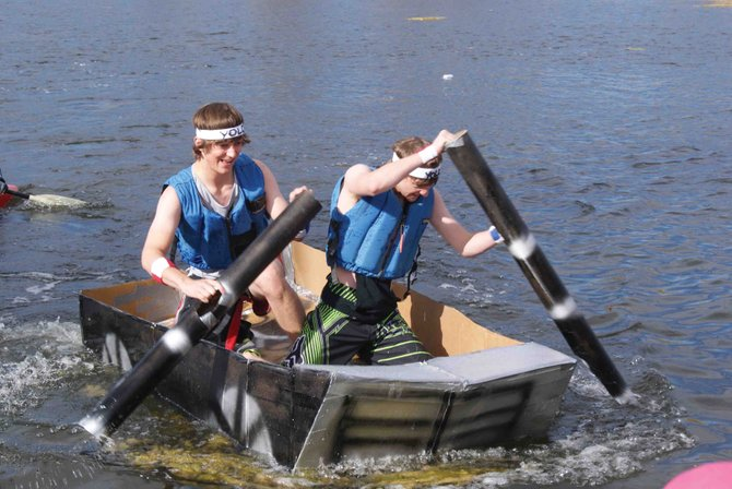 Matt Balderston, left, and Ben East compete Friday in the Moffat County High School Science Olympic's event, the Great Cardboard Boat Regatta. Balderston and East won fastest boat.