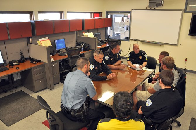 Steamboat Springs Police Department officers attend a daily briefing last month at the police headquarters on Yampa Street. The Steamboat Springs City Council on Oct. 16 will hear more detailed versions of proposals to build a new police station at the Iron Horse Inn site or next to the Stock Bridge Transit Center.