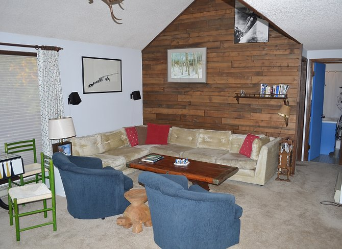 The spacious living room of the 1972-era home also has a gas fireplace faced in stone that is not visible in this picture.