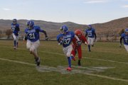 Alex Neverez (37) returns an interception in the third quarter of Saturday's Craig Middle School vs. Steamboat Springs seventh-grade football game at the Bulldog Proving Grounds. Alex would bring the pick into Sailors territory with help from a convoy of blockers, including Kaden Hafey (21).