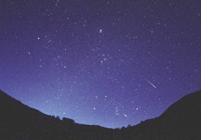 "A fiery meteor, or ""shooting star,"" streaks past the constellation Orion in this photo taken in 2008."