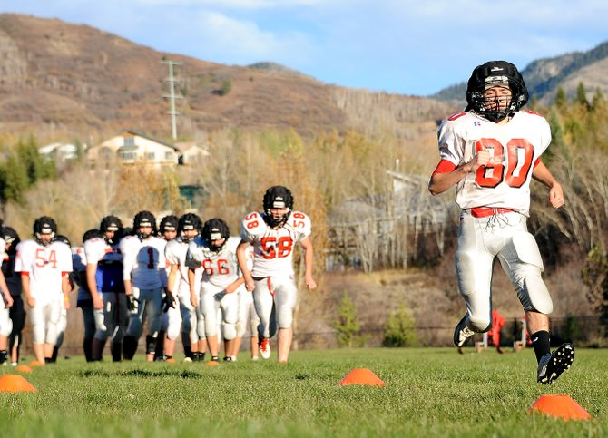 Jimmy Weltzheimer leads off for the Steamboat Springs High School football team during an endurance drill Monday. Weltzheimer scored a touchdown with a fumble return Friday as the Sailors beat Battle Mountain to improve to 3-3.