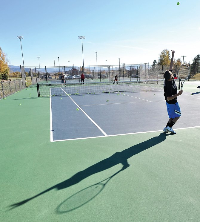 Steamboat Springs High School's Zack Dunklin works on his serve Tuesday afternoon at the Tennis Center at Steamboat Springs. Dunklin and his teammates are preparing for the state tennis tournament, which will begin in Pueblo on Thursday.