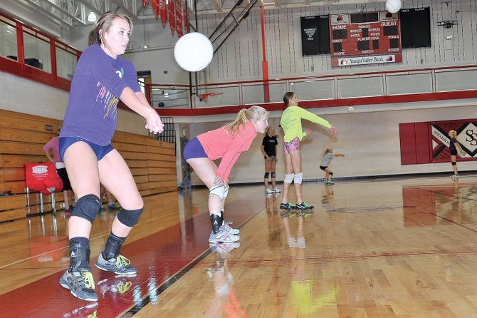 Steamboat Springs senior Alex Feeley works on receiving the ball during practice Wednesday afternoon at the Steamboat Springs High School. The girls will travel to Palisade on Friday night before returning home to play Delta on Saturday.