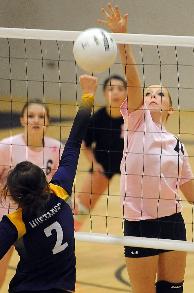 Hayden's Miranda Watts taps a ball back over the net Saturday as the Tigers battled West Grand. Hayden lost the match in three games.