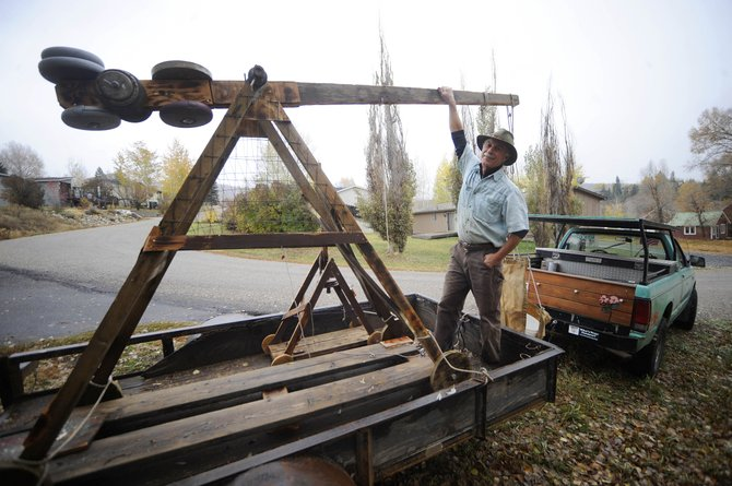 Steamboat Springs resident Johnny Walker plans to launch computer monitors with this trebuchet he built.