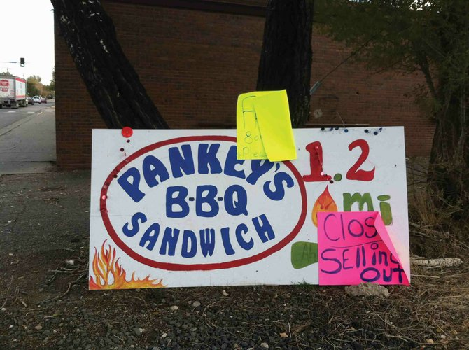 A sign for Pankey's Smoked BBQ now features a closed sign posted on it. Pankey's closed after a little over a year in business.