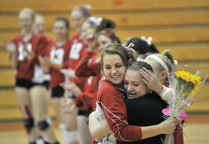 Steamboat Springs' Alex Feeley, left, hugs fellow senior Nikki Fry, who has been injured this season, during senior night at the Steamboat Springs High School gym. The Sailors recognized Feeley, Fry  and Emily Spiess at the start of the game against Middle Park.