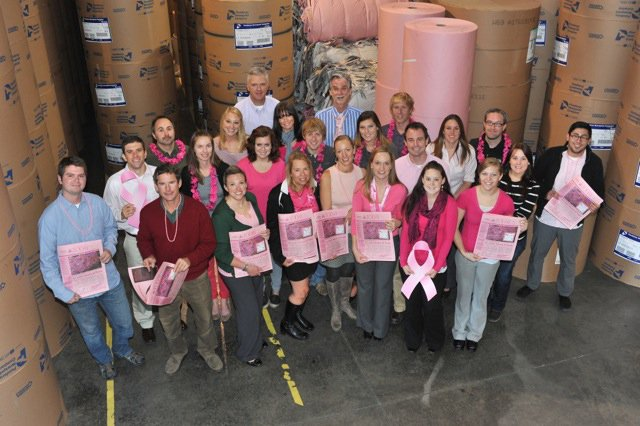 The staff of the Steamboat Today poses with the Oct. 15 pink issue.