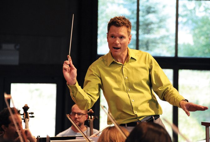 Steamboat Symphony Orchestra music director Ernest Richardson leads a rehearsal in August at Strings Music Pavilion. The orchestra is struggling financially and is in danger of canceling its December Holiday Concert.