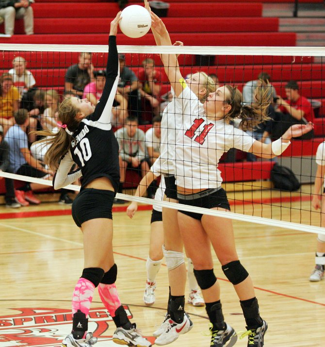 Glenwood Springs junior Delaney Gaddis, left, and Steamboat Springs senior Alex Feeley battle for a ball at the net during Thursday's match in Glenwood. Gaddis and the Demons held on for a five-game win.