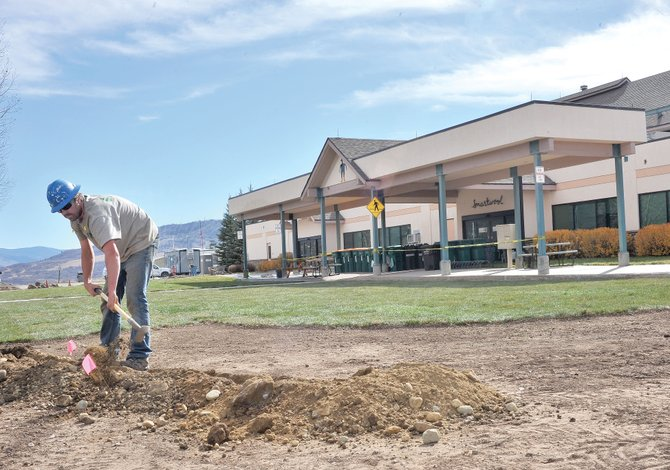 Mountain West employee Brad Sandifer works on the irrigation system in an area recently updated at SmartWool. The local company recently began a $1.45 million facility renovation.