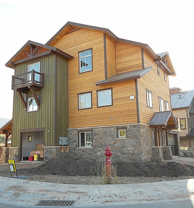 One new duplex townhome building at Rocky Peak Village nearly is completed and a second is expected to begin framing this week.