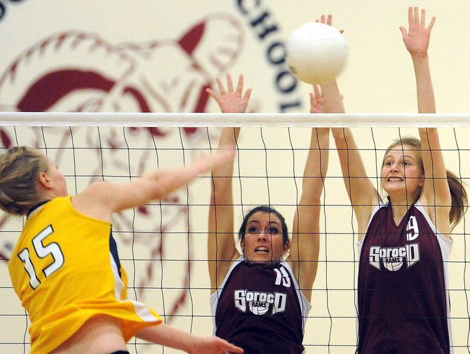 Soroco's Billie Bratton, left, and Josie Rossi go up for a block Saturday against North Park. The Rams lost the match in four sets. They return to action Friday in the district tournament.