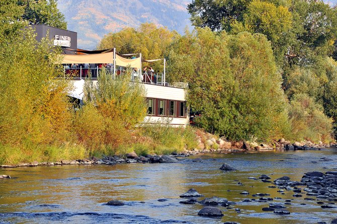 Diners sit on Sweetwater Grill's outdoor patio overlooking the Yampa River last month. Downtown stakeholders are meeting Monday to discuss potential funding mechanisms for Yampa Street improvements.