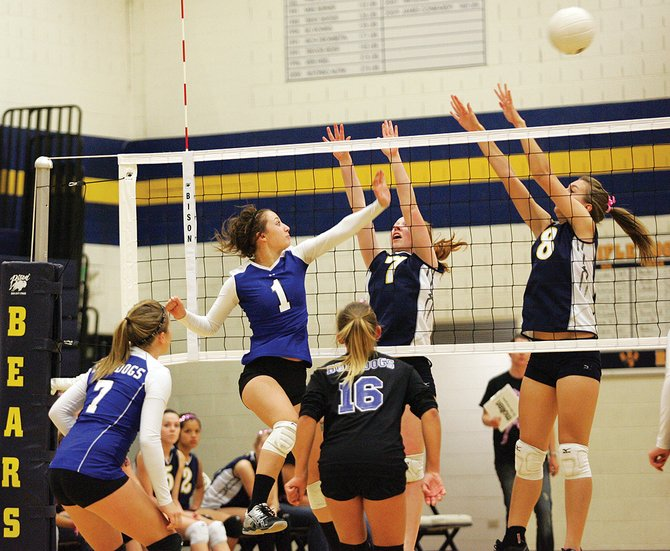 Moffat County's Brittany Walker sends a shot over the net during last Tuesday's volleyball match at Rifle. Moffat County won that match in three sets. The Bulldogs will go to the Western Slope League tournament at Grand Junction Central High School this weekend.