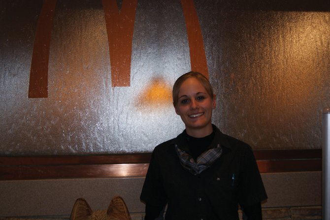 Craig McDonald's general manager Emily Willems stands in front of the fountain inside McDonald's. What began as a part time job when she was 16 has become a career path for Willems.