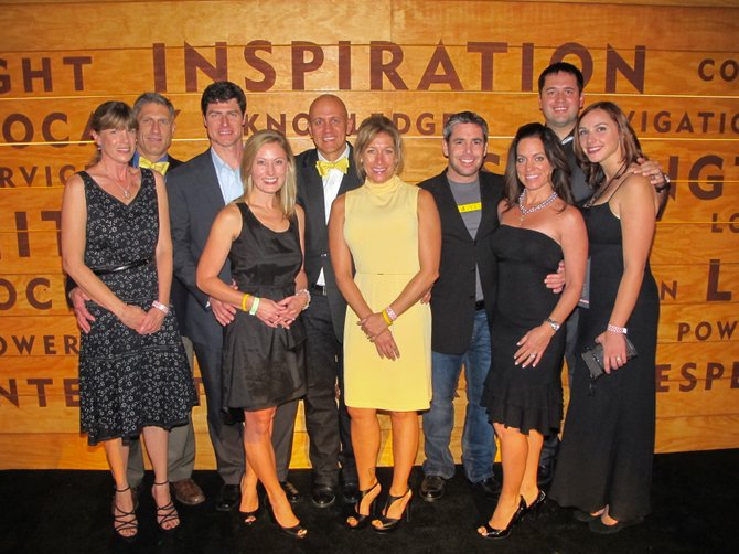 Jennifer and Darren Robinson, from left, Kerry and Jennifer Shea, Chad and Sabrina James, Dave and Aimee Nagel and Casey and Amanda Barnett prepare for the gala at the Ride for the Roses event in Austin, Texas. The event recognized the biggest contributing organizations to Livestrong.