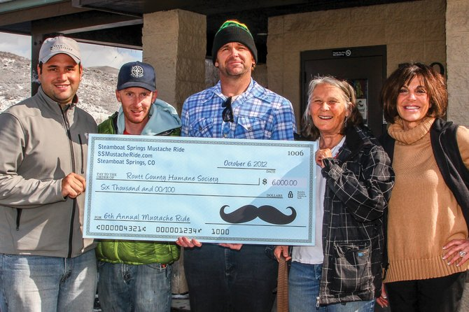 Mustache Ride event organizers, from left, Casey Barnett, Nate Bird and Rob Peterson present a check to the Routt County Humane Society's Maggie Smith and Ellen Archer, far right. The Oct. 6 fundraiser collected $6,000 for the local nonprofit.