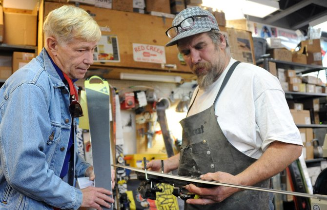 Tim Magill consults with Olympic moguls skier Jorge Torella about a tuneup on a pair of skis Thursday at Steamboat Ski & Bike Kare in Steamboat Springs.