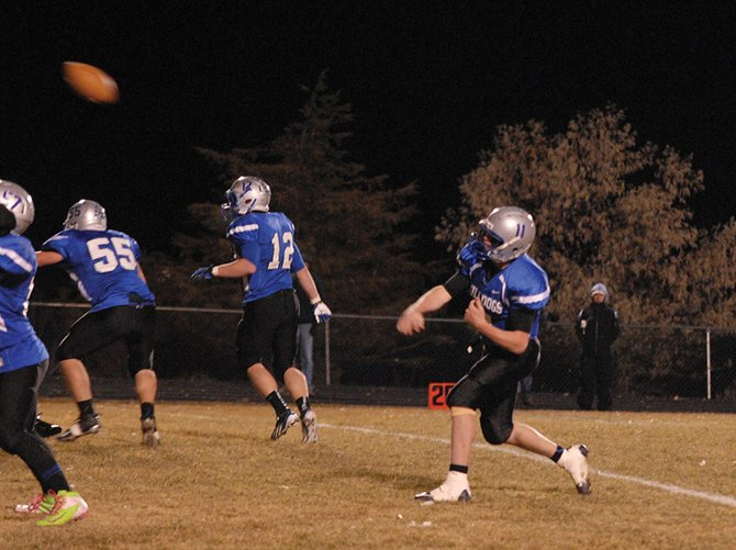 Bubba Ivers unleashes a deep throw during the first half of Friday night's game at the Bulldog Proving Grounds. Ivers threw for two touchdowns and rushed for two more in the game as Moffat County rolled, beating Battle Mountain 48-14.