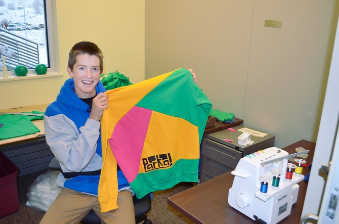 The Lowell Whiteman School student Logan Banning, owner of Parka, shows off one of his custom hoodies this week in his office at the new Yampa Valley Entrepreneurship Center at Colorado Mountain College.