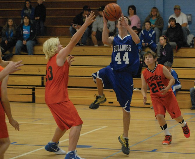 Joe Selbach goes up for a layup during the eighth-grade Craig Middle School vs. Hayden basketball game Saturday at CMS. Selbach scored 21 points, and the Bulldogs won, 33-16.