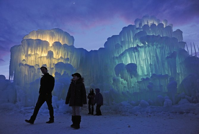 Emily Banville, 11, second from left and her father, Mike, left, of Englewood, begin a tour of the illuminated ice castles in Silverthorne last winter. The creators will be growing a similar structure in Ski Time Square this winter, one of only two they're making in the world this year. The other ice castle will be at the Mall of America.