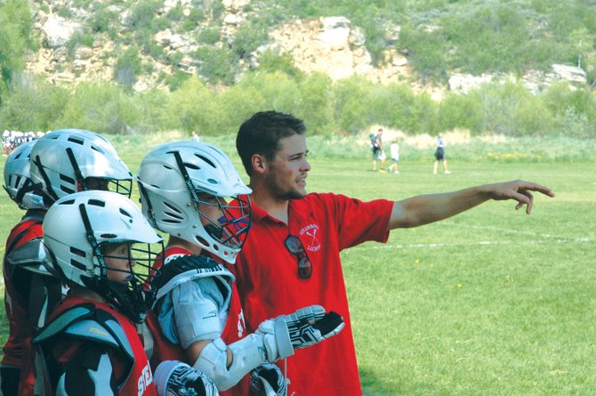 Jake Flax helps coach a team at a lacrosse tournament during the summer. Jake, along with his brother Andy, will take over Steamboat Youth Lacrosse.