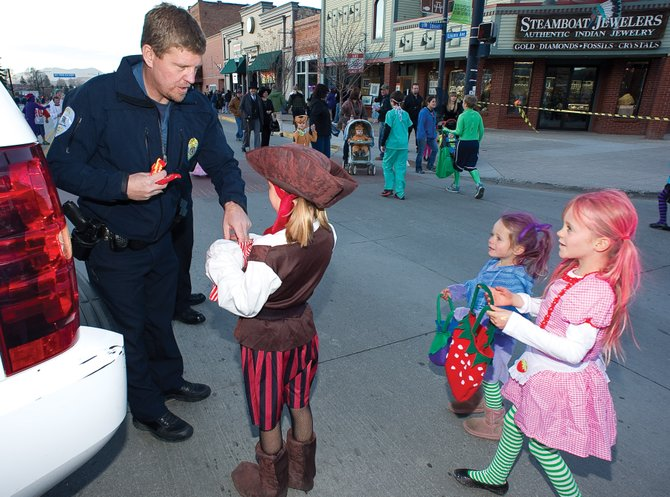 Steamboat Springs Police Chief Joel Rae hands out candy during 2011's Downtown Halloween Stroll on Lincoln Avenue. This year's event is from 5 to 7 p.m. Wednesday.