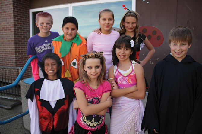 Fifth grade students at Sandrock Elementary School show off their Halloween costumes. (Front, from left) Max Perez, Elizabeth Voiland, Mandy Cazares, (Back, from left) Keaton Durbin, Christopher Harmon, David Lopez, Tauren Farquharsan and Mckenzie Guevara.